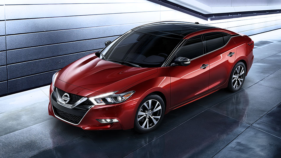 nissan-maxima-coulis-red-aerial-side-view